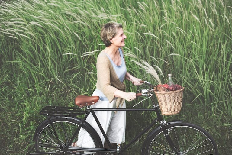 Bicycles-and-Seniors - A Woman Standing by a Bike