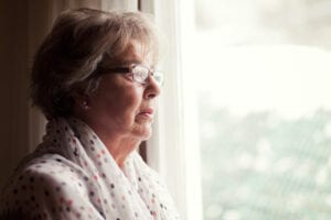 Woman Depressed Looking Out a Window