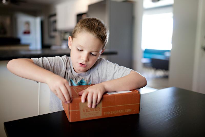 Boy Opening a Box