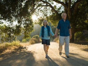 Mature Couple Walking Down a Dirt Road