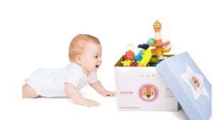 Baby Crawling Toward Box of Toys