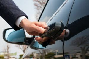 Car Battery Jump Starter - Close Up of Male Hand Opening Car Door