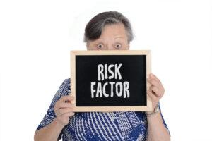 Osteoarthritis vs Rheumatoid Arthritis - Older Woman Holding Sign Stating Risk Factor