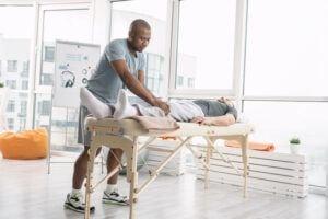 Osteoarthritis vs Rheumatoid Arthritis - Physical Therapist Working on Client