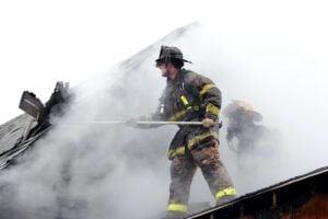 Fire Fighter Battling Home Fire