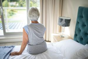 In Home Safety for the Elderly-Senior Woman Sitting on a Bed