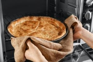 In Home Safety for the Elderly-Woman Taking Pie Out of Oven