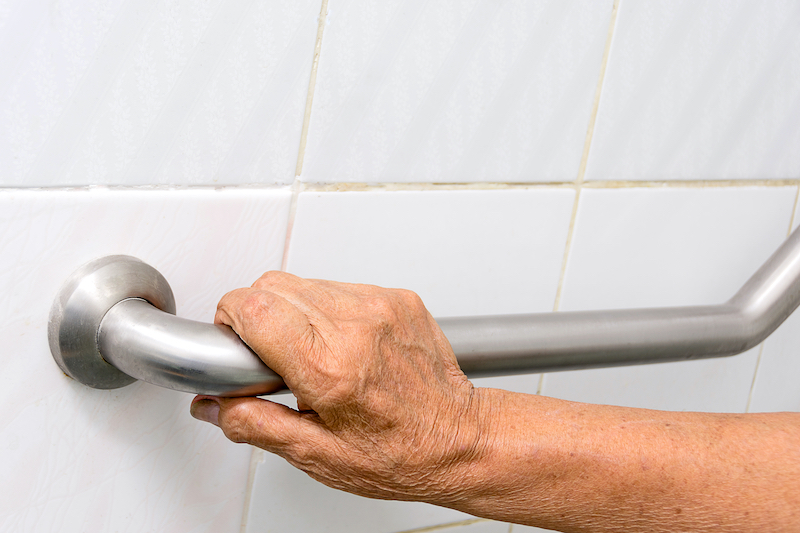 In Home Safety for the Elderly-Elderly Woman Holding a Grab Bar