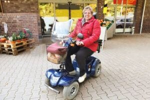 Electric Scooters for Seniors - Woman Setting on Mobility Scooter