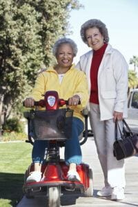 Electric Scooters for Seniors Buyers Guide - Electric Scooters for Seniors - Woman on Mobility Scooter